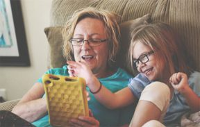 grandmother and grand daughter using tablet