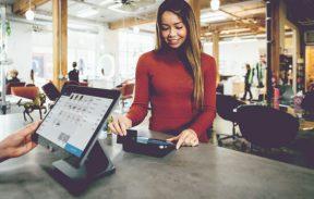 customer using credit card swiper