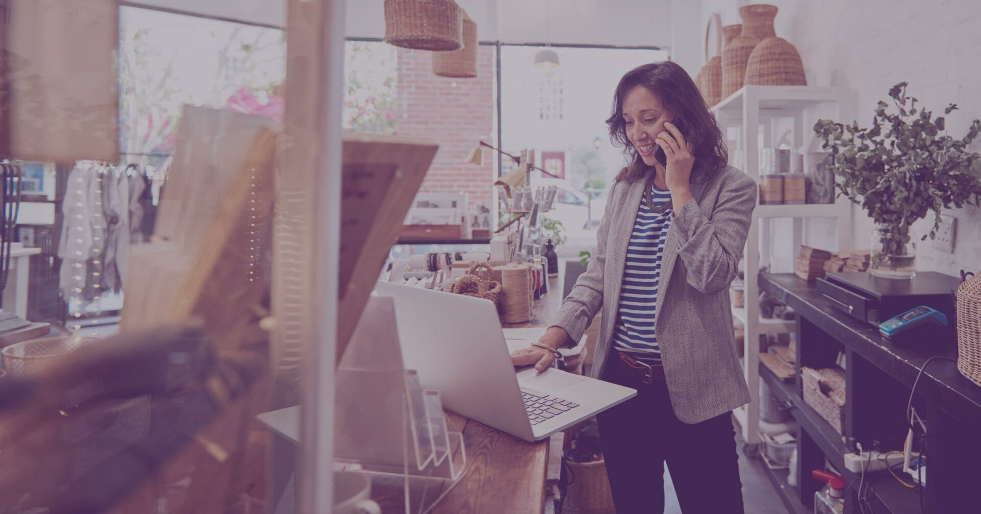 female business owner talking on cell phone