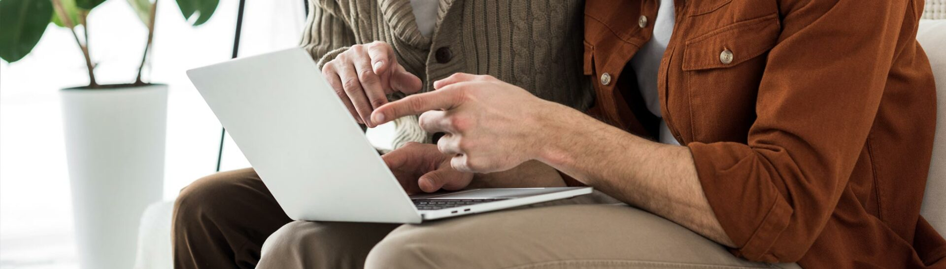 elderly couple signing up to newsletter
