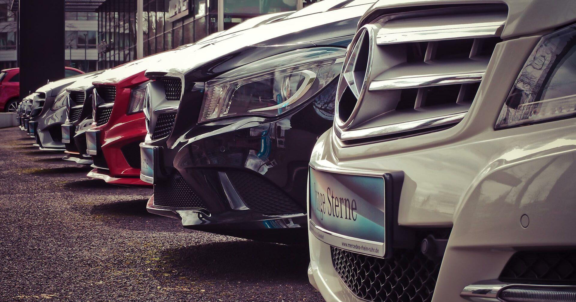 luxury car dealership lot photo