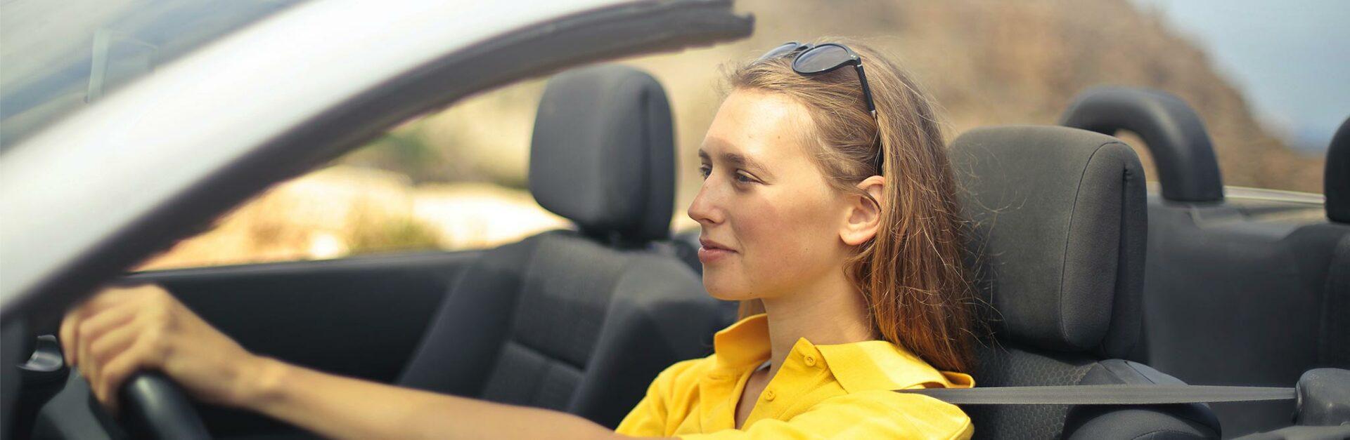 woman driving convertible car